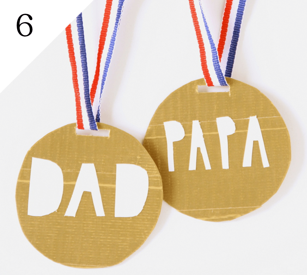 Dad on top of the podium with this easy craft by And We Play