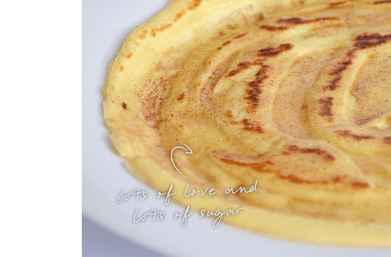 Close up of a crepe topped with sugar and cinnamon.