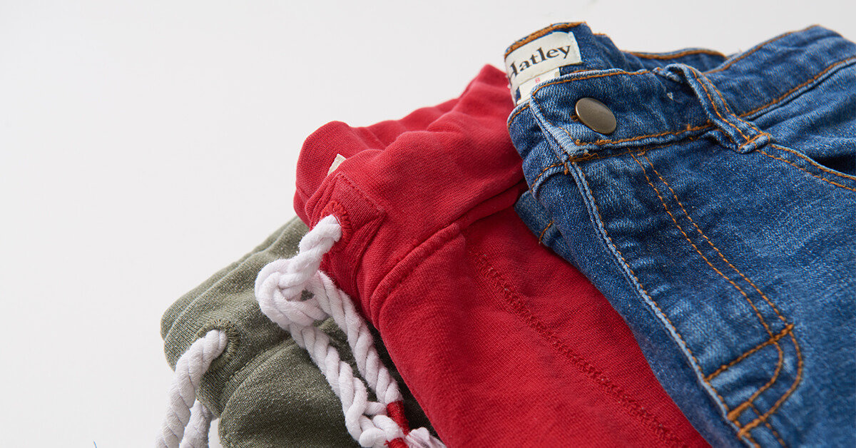 Stack of 3 boys bottoms: sweat pants and jeans.